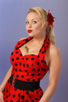 Cute Pinup Girl In Red Dress With Tattoo Royalty Free Stock Photo