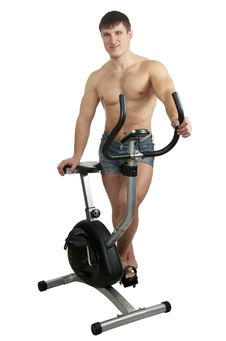Man And  Exercise Bicycle Royalty Free Stock Photography