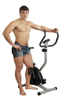 Free Man Stands Near To  Exercise Bicycle Royalty Free Stock Image - 7972826
