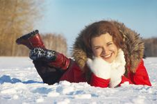 Portrait The Young Girl Lays On White Snow Stock Photography