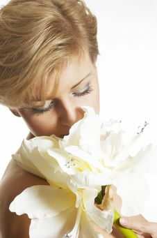 Free Beautiful Girl Smells Flower Royalty Free Stock Image - 7973386