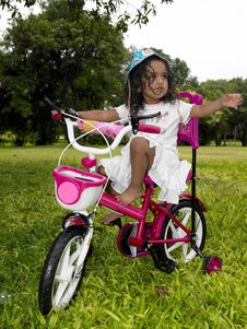 Free Girl In The Garden Riding Her Cycle Royalty Free Stock Images - 7973639