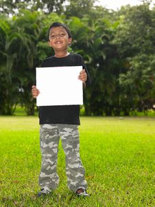 Free Boy With A Blank Placard In The Garden Stock Photo - 7973910