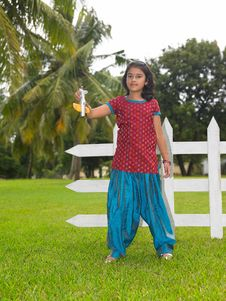 Free Kid In The Park With Her Toy Aeroplane Stock Photo - 7974090