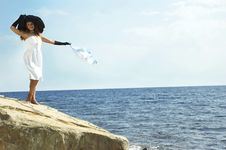 Free Girl In A Black Hat Holds Headscarf On A Wind Royalty Free Stock Image - 7974406