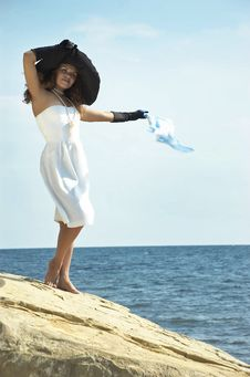 Free Girl  Holds Headscarf On A Wind Stock Photos - 7974413