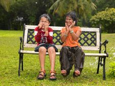 Free Asian Kids Playing In The Rain Stock Photos - 7974663