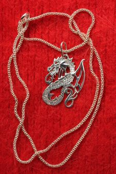 Free Silver Necklace - A Dragon. Stock Images - 7976044