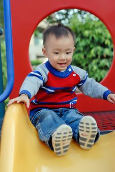 Free Asian Boy Playing The Sliding Board Stock Photo - 7978380
