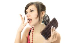 Free Young  Woman Eating Chocolate Stock Images - 7978894