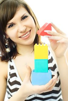 Free Beautiful Young Woman Building A Toy House Stock Image - 7979051