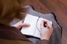 Free Female Writes Notes In Notebook Stock Photos - 7979693