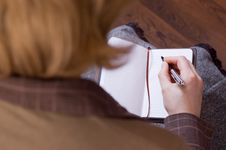 Free Female Writes Notes In Notebook Royalty Free Stock Image - 7979706