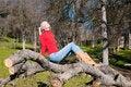 Free Girl Sunning On Fallen Oak Royalty Free Stock Photography - 7980547
