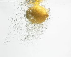Lemon Is Dropped Into Clean Water 2. Stock Image