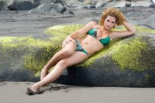 Free Woman Lying On The Rocks Royalty Free Stock Photography - 7980347