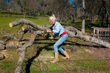 Free Woman Chain Sawing An Oak Tree Royalty Free Stock Photos - 7980368