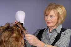 Attractive Older Lady Hair Stylist Stock Photos