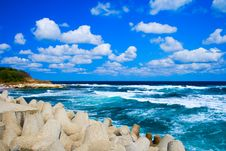 Cloudy Blue Sky And Sea Waves Royalty Free Stock Photos