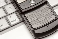 Free Cell Phone On Laptop Macro Royalty Free Stock Images - 7982459