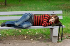 Free Girl Sleeping On A Park Bench Royalty Free Stock Images - 7986369