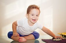 Free Small Boy Playing With A Toy Stock Photo - 7989490