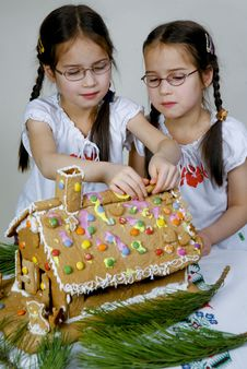 Twins Decorating Stock Photography