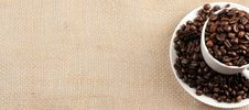 Free Coffee Cup And Beans On Jute Sack Stock Photography - 7990492