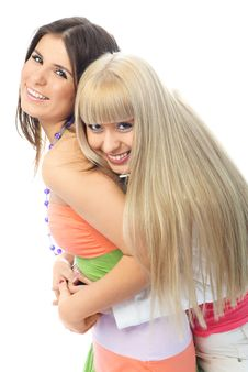 Two Friends Embrace And Laugh Stock Photo