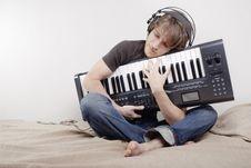 Free Man Hugs A MIDI-keyboard Royalty Free Stock Photo - 7993545