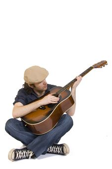 Free Man Playing His Guitar Seated Stock Image - 7993701