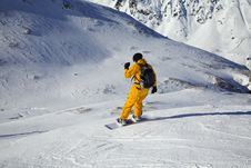 Free Snowboarder Looking Down The Slope. Sunny DaySnowb Stock Photo - 7994020