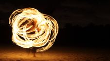 Fire Dancer In The Dark Stock Photo