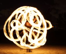Fire Dancer In The Dark Stock Images