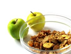 Muesli In A Glanse Dish With Two Apple Isolated Stock Photo