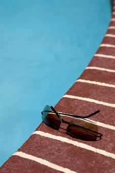 Free Sun Glasses By Pool Royalty Free Stock Photography - 803947