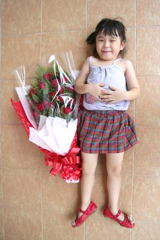 Girl & Bouquet Of Roses Lying On The Floor, Full Shot Stock Photography
