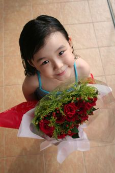 Free Girl Standing & Holding Bouquet Of Roses Stock Photo - 807550