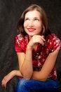 Free Pretty Girl Sitting Smiling On Black Stock Photos - 8000683