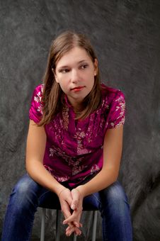 Free Girl Sitting On Chair With Hands Crossed Stock Photos - 8000513