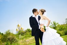 Kiss Of Bride And Groom Stock Photography