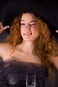 Free Winking Red-haired Girl In Hat Stock Photography - 8001732