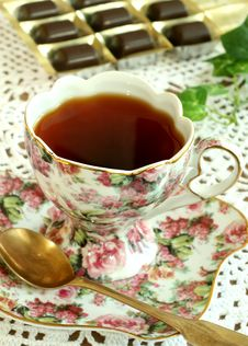 Free Cup Of Tea And Chocolates On Knitted Table Cover Stock Photo - 8005670