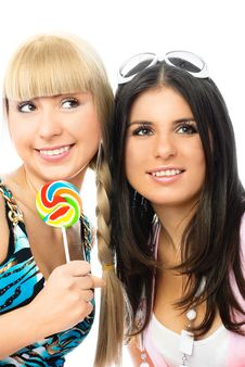 Two Beautiful Happy Girls With A Lollipop Stock Images