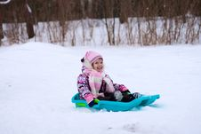 Free Smileing Little Girl On Sleigh. Stock Photography - 8011582