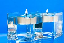 Blue Candles In Glass Royalty Free Stock Photo