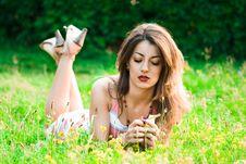 Free Beautiful Woman Lies On A Grass Stock Photos - 8012033