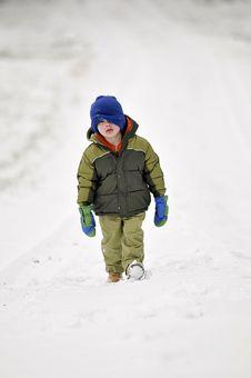 Little Boy Walking In Snow Royalty Free Stock Photo