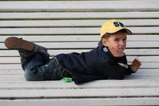 Free Boy On A Bench Royalty Free Stock Photography - 8017597