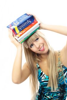 Blond Girl Holding A Lot Of Book On Her Head Stock Image